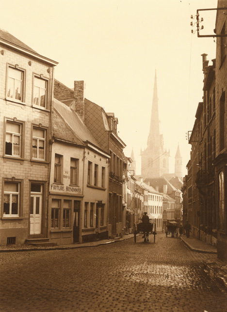 Leonard Misonne - A Cobblestone Street with Horse Carriages in Nivelles, Belgium