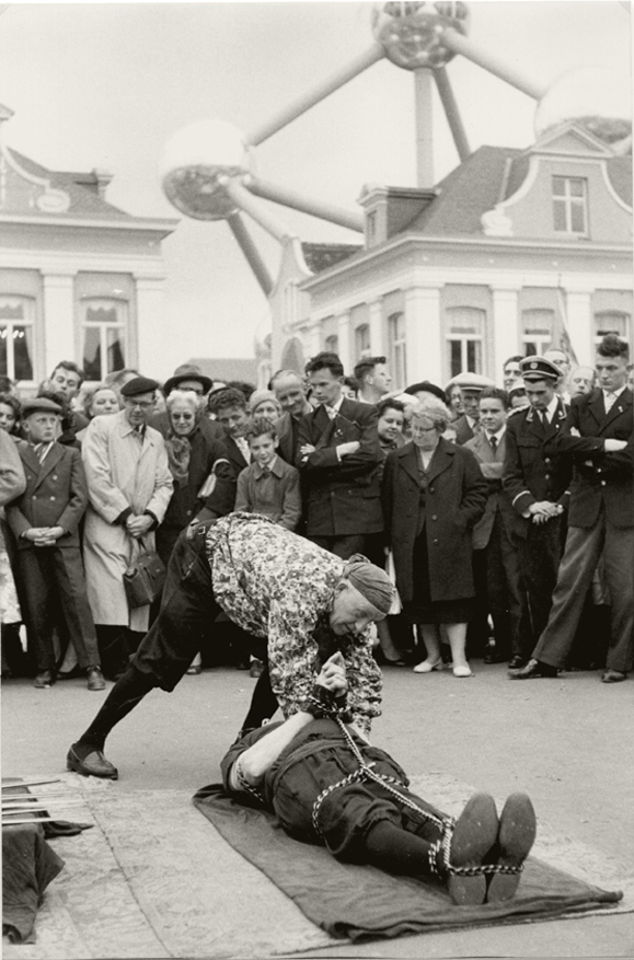 Henri Cartier-Bresson - Escape-Artist Performance in front of Atomium, Brussels World Fair