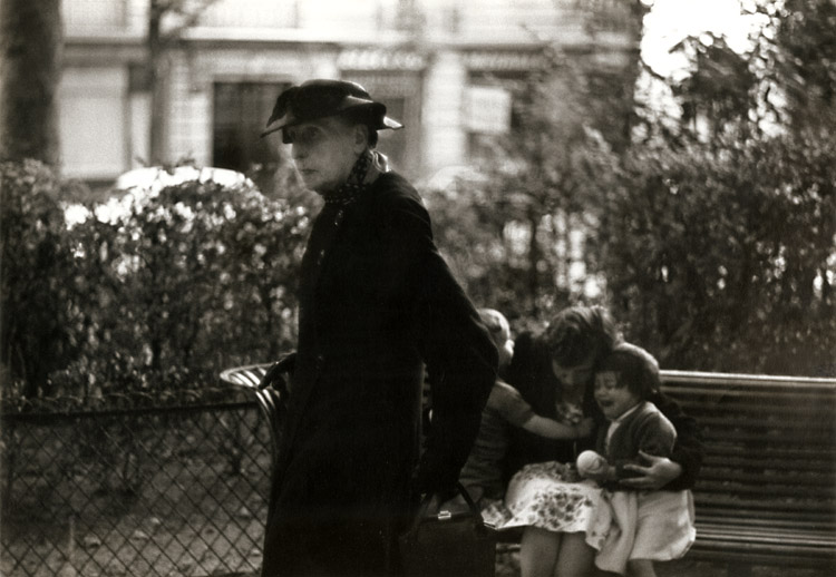 Bruce Davidson - Widow of Montmartre, Mme. Fauché (with Children Comforted by Their Mother on Park Bench)