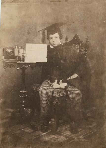 Anonymous (English) - Young Graduate with Rare Lens, Stereo Viewer, Sign and a Cat in His Lap