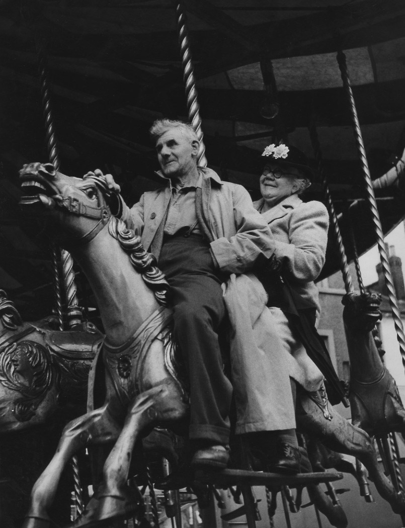 Izis (Israel Bidermanas) - A Couple on Carousel during August Bank Holiday Fair, London