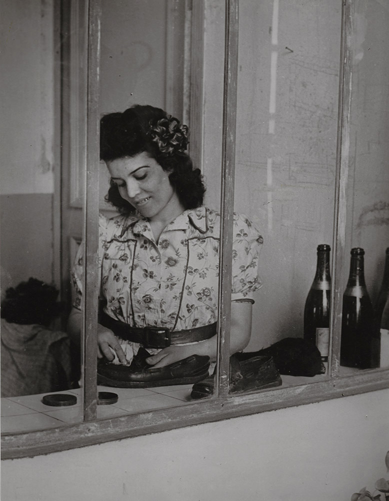 Brassai (Gyula Halasz) - Picasso's Maid, Inès, with Wine Bottles and Shoes