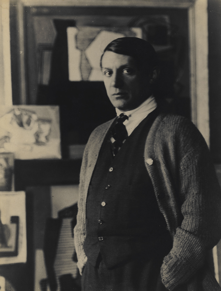Man Ray - A Young Pablo Picasso in His Studio in Front of Paintings
