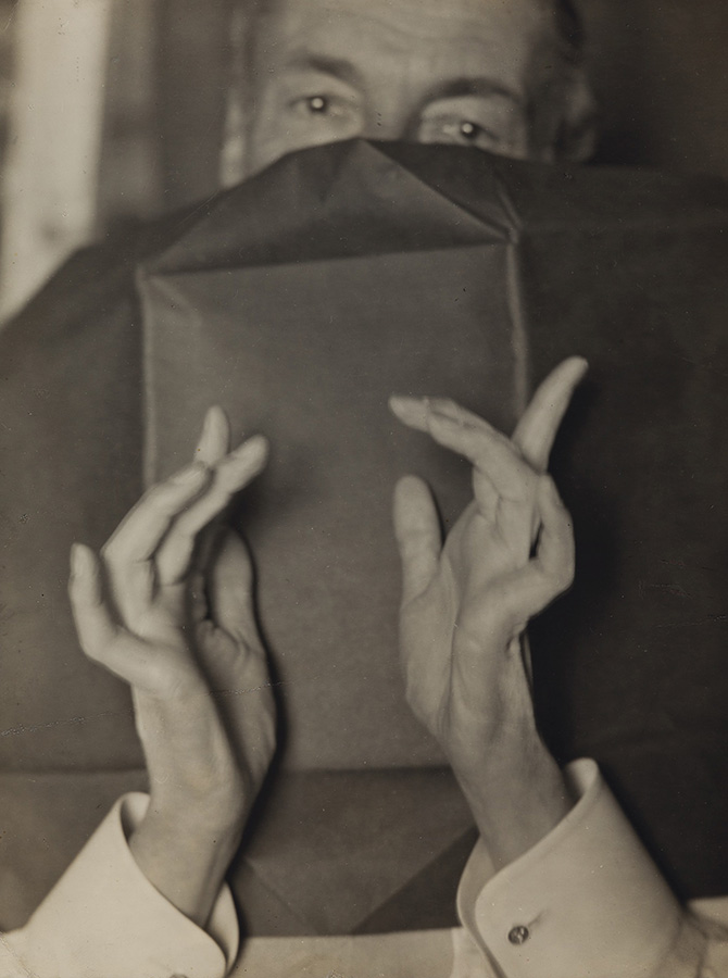 Man Ray - Portrait of a Half-Hidden Man With Expressive Hands (Russell H. Greeley)