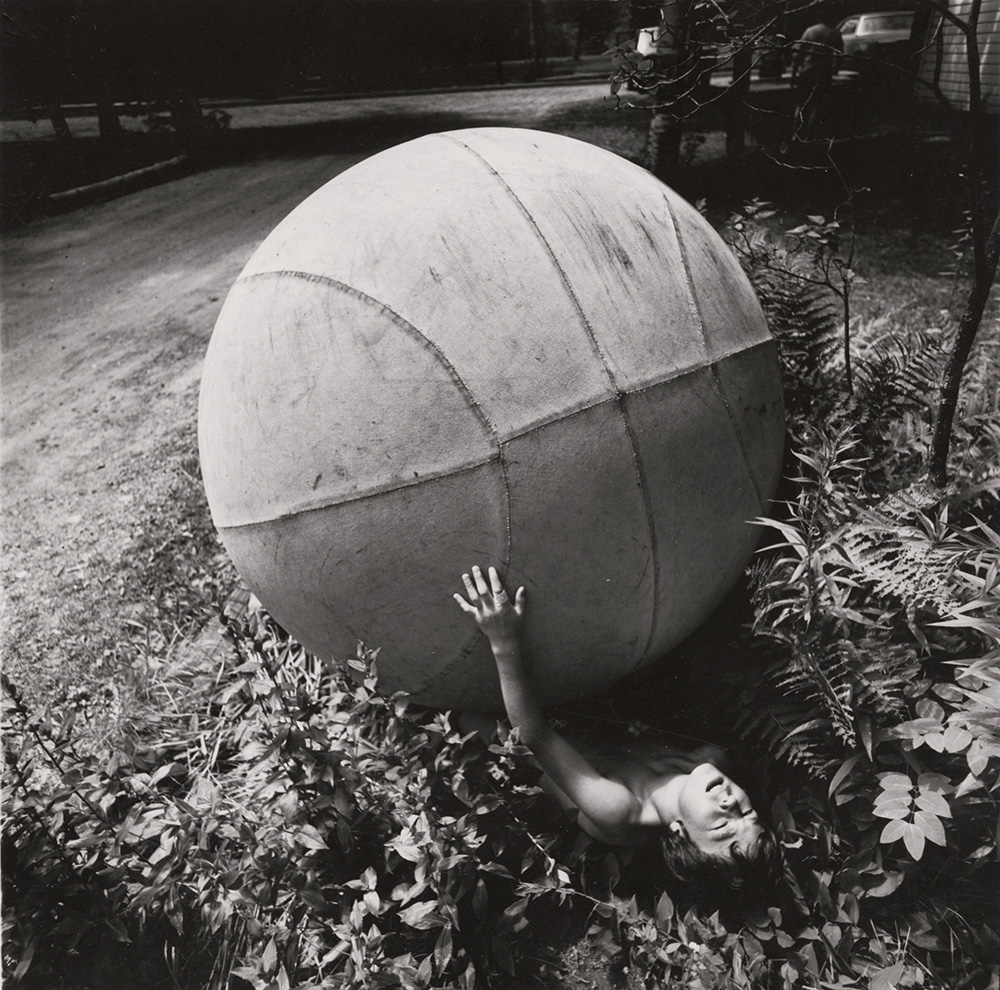 Boy with Giant Ball, New York