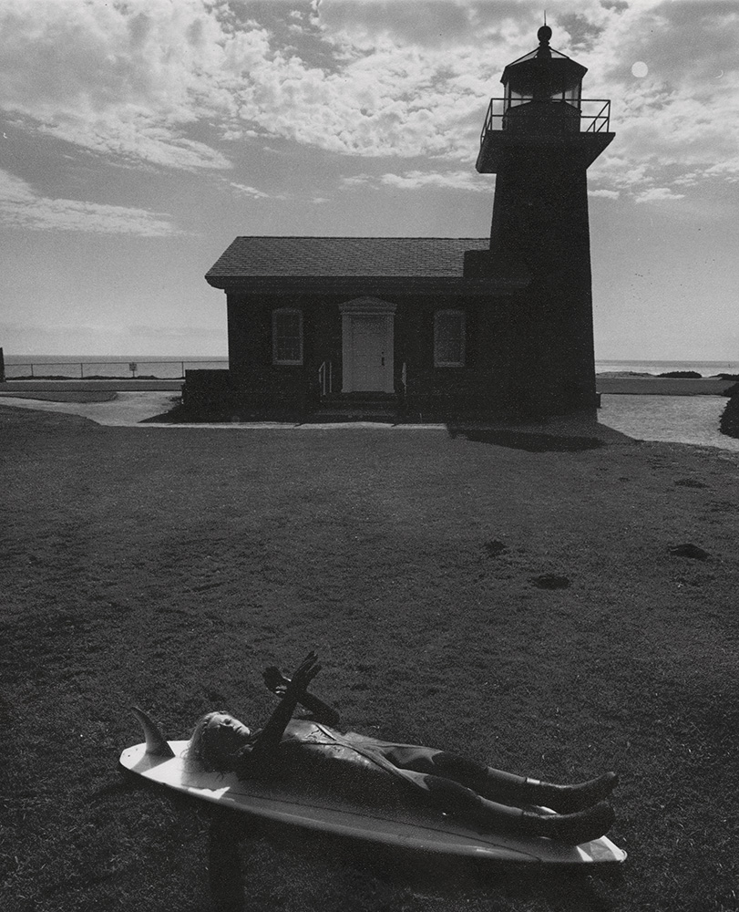 Arthur Tress - Lighthouse with Child Lying on Surfboard (Surfer's Dream)