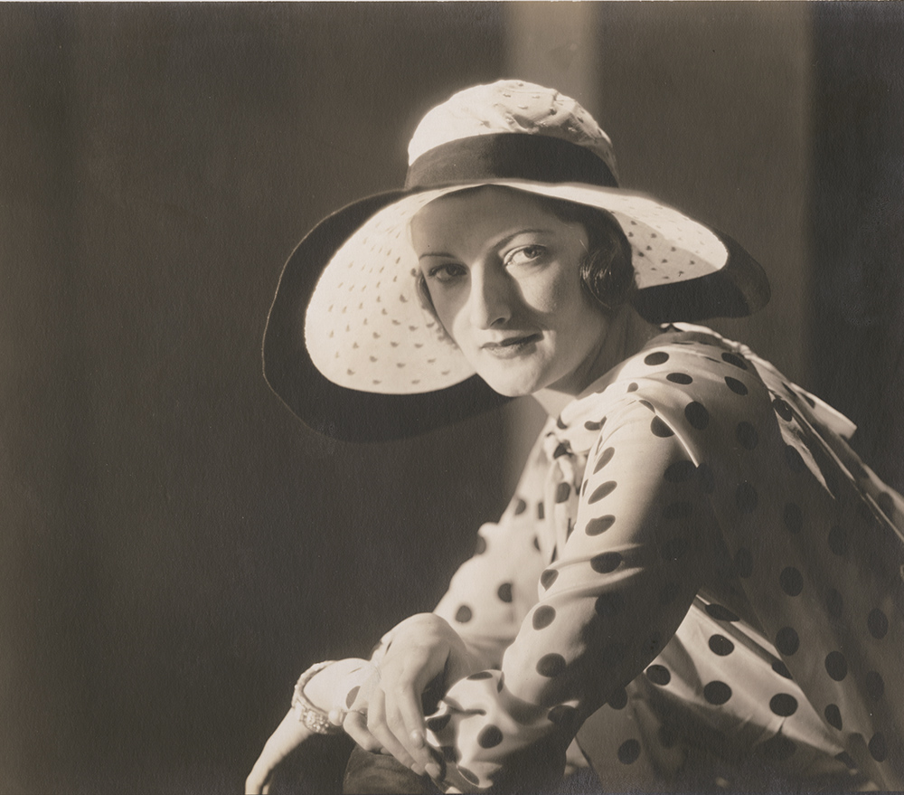 Vogue Magazine Photographer - Woman in Polka Dot Shirt and Hat
