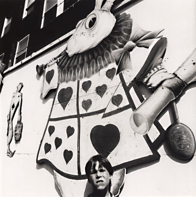 Arthur Tress - Boy with Picture of Alice's Rabbit in Rockaway Playland, Queens, NY