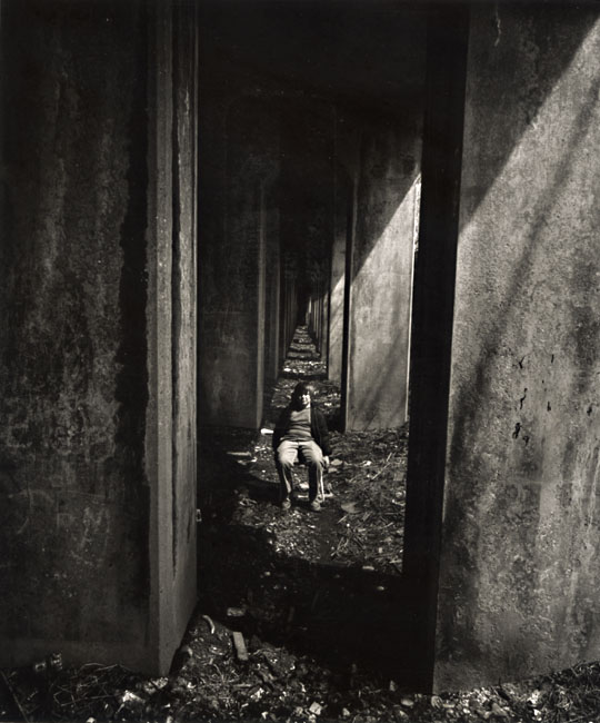 Arthur Tress - A Boy Sits under an Abandoned Railroad Track, Staten Island, NY