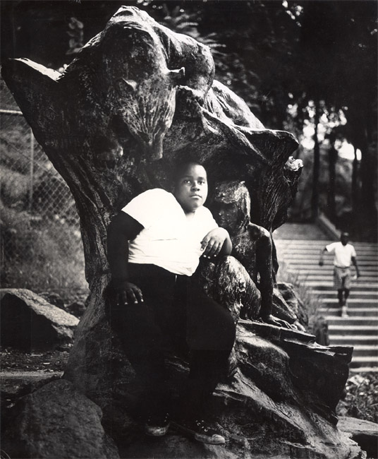 Arthur Tress - In an Old Bronze Statue a Negro Youth Sits in Morningside Park, NYC