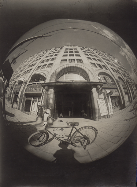 Osaka Asahi Shinbun - The Doshima Building, Osaka, as Seen Through Early Prototype of the Fisheye Lens