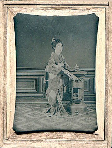 Anonymous - Studio Portrait of a Japanese Maiko Holding a Hagoita (decorative wooden paddle)