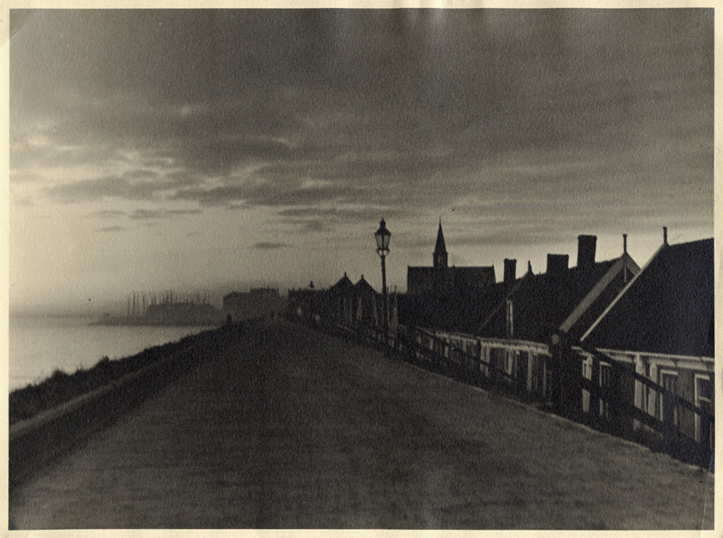 Anonymous (Tokyo Archive) - Road along river with church spire and houses.