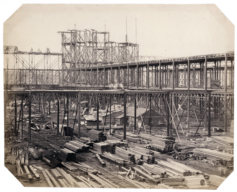 B. L. Spackman (attributed to) - Construction of the 1862 International Exhibition at South Kensington [Early Construction View with Lumber Stacks]
