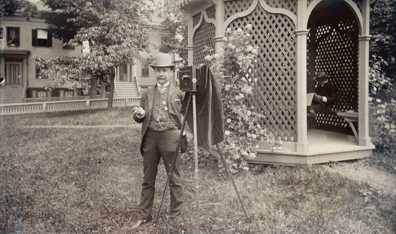 Anonymous, American - Portrait of a Photographer with his Camera in a Park with a Gazebo